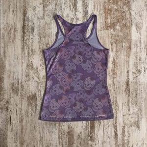 Camiseta tirantes calidad premium #elartedecorrer, color lila de fondo y tirante nadador. Parte posterior.