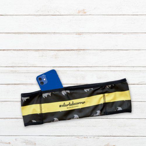 cinturon deportivo batman amarillo trasero elartedecorrer